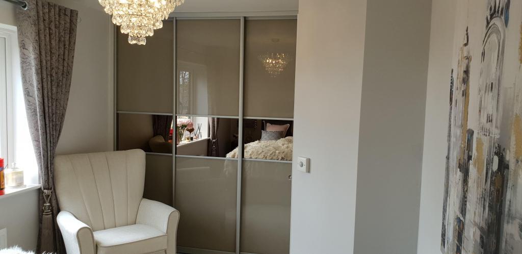 High gloss sliding door wardrobe