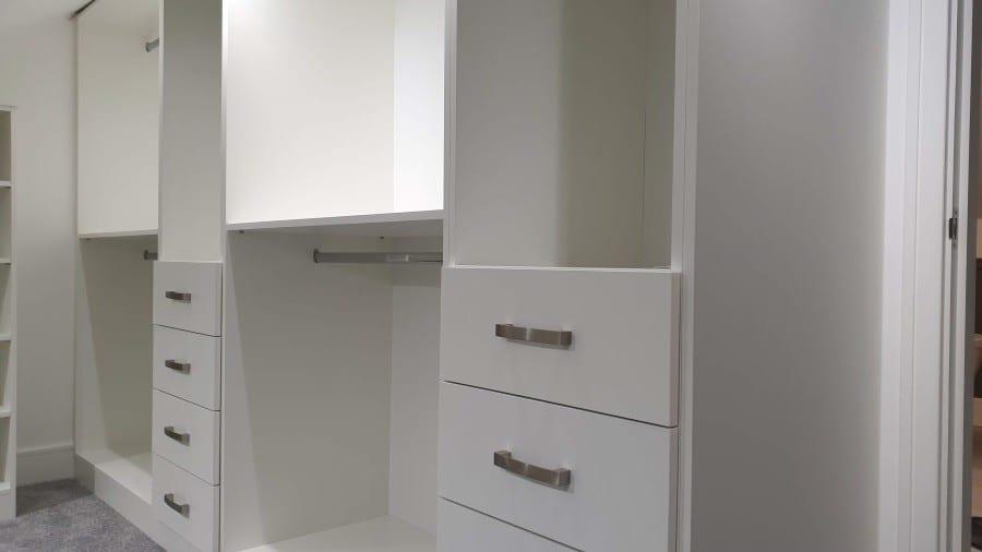 White mat walk in wardrobe
